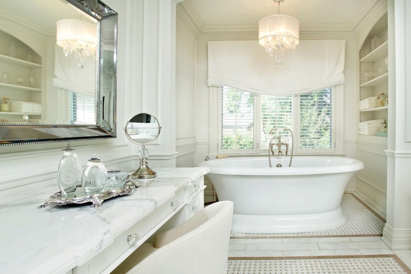 polished nickel mirror white acrylic bathtub windows white shade white vanity white marble countertop chandelier white chair built in shelves
