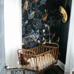 Rattan Baby Cot In A Nursery With Animals Wallpaper, Blue Rug, White Curtain