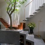 Stairs With Concrete And Wooden Materials Combine For The Steps, A Tree Plant In The Intersection, Pots Of Plants