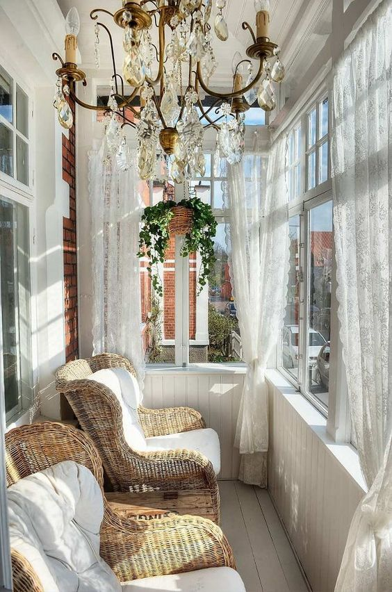 sun room with white wooden floor and wall, white curtain, rattan chairs with white cushion