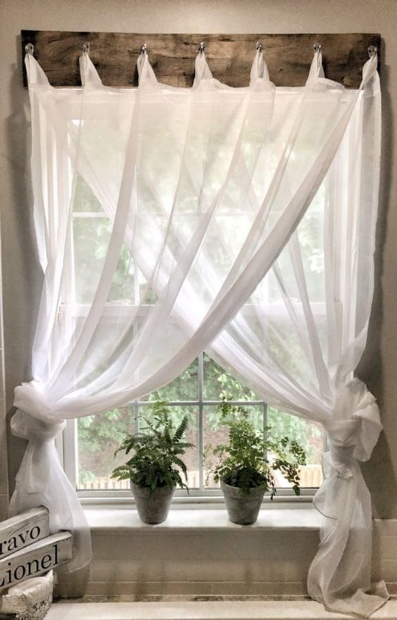 white see through drapery curtain