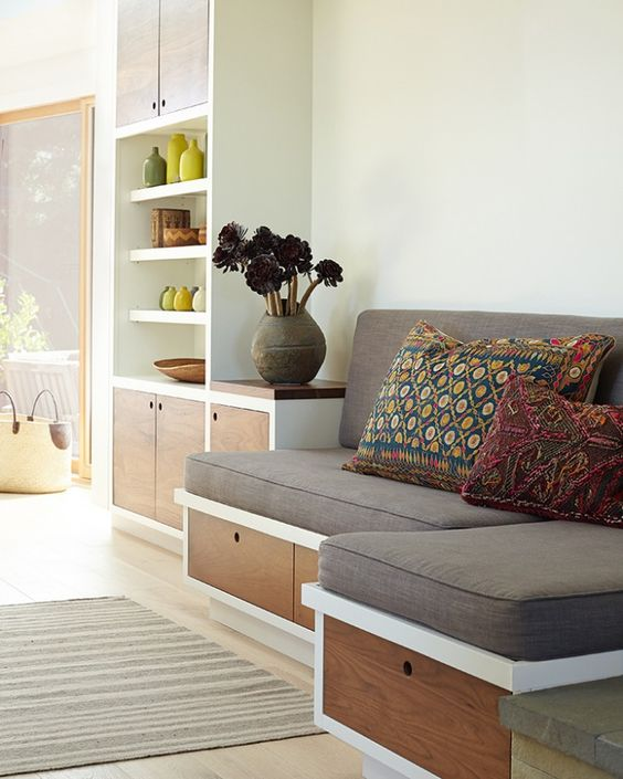 wooden bench with white and brown wood, grey cushions, colorful pillows