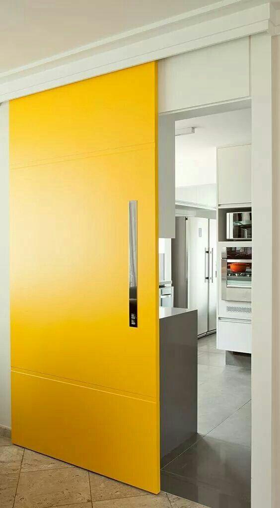 bright yellow sliding door