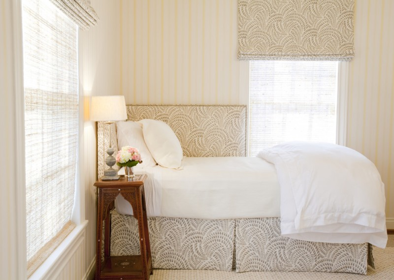 daybed room ideas white curtain roman shade patterned bed skirt corner headboard white bedding antique wooden side table white pillows windows table lamp
