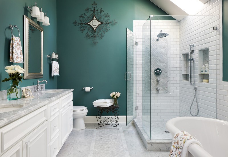 frameless shower door sweep teal walls white wall tile white flooring iron side table white vanity white vanity white bathtub wall mirror wall sconce shower fixture