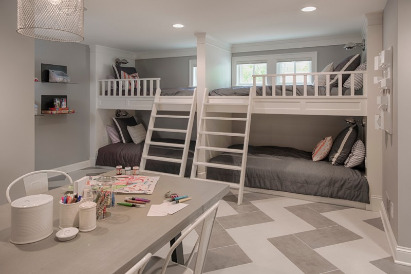 gray table built in bunk beds windowsn herringbone ceramic flooring white chairs pendant lamp grey beddings wall mounted shelves ladders pillows
