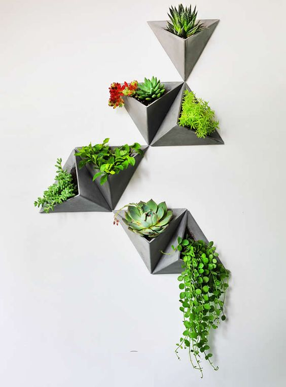 grey triangular pyramids wall planters that open in one side