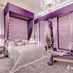 Light Purple Pillows Crystal Chandelier Purple Tufted Headboard Purple Wallpaper Purple Bedding Purple Bench Area Rug Nightstands Table Lamps