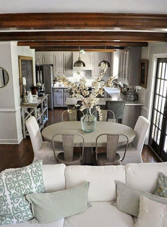 open space with elegant kitchen, dining set, white sofa for living room