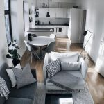 Open Space With White Wall, Brown Flooring, White Cabinet, Black Lamp, Grey Sofa, Grey Rug Living Space