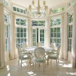 Round Snuroom With White Marble Floor, White Wooden Framed Windows, Dome Ceiling With Chandelier