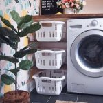 Small Space For Laundry Machines, White Baskets On Shelves
