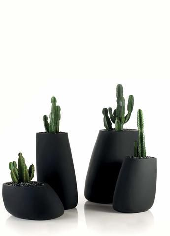 smooth black stone pots, artistic