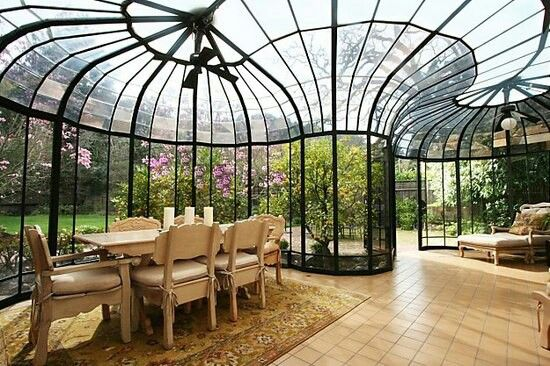 sunroom with amazing glass ceiling, wall, nude tiles, nude wooden dining set, ceiling fan