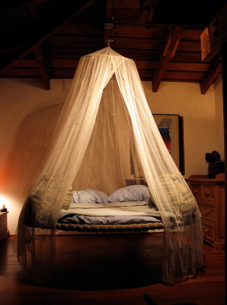 swing hammock bed white hammock bed drape round bed blue pillows blue bedding wooden beams wooden floor wooden dresser artwork