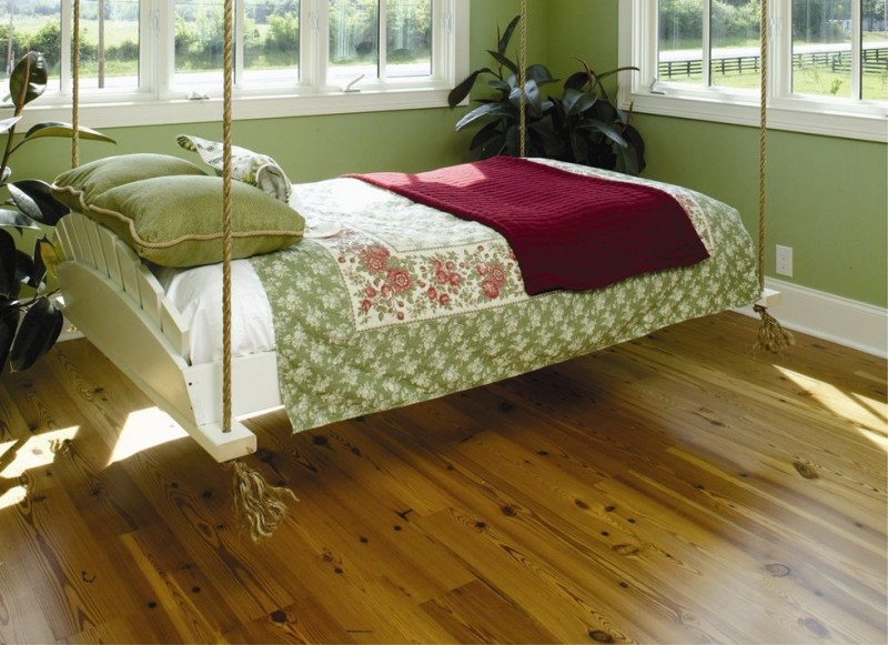 swing hammock bed white wooden bed rope wooden floor white bed green blanket green pillows green walls glass windows