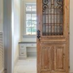 Wooden Sliding Door With Raw Looking Wood And Rustic Metal