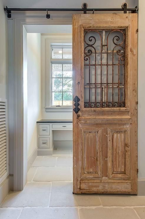 wooden sliding door with raw looking wood and rustic metal