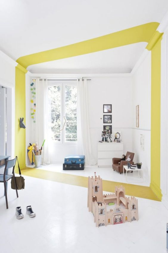 a line of yellow paint crossing in the middle of the room with white painted wall