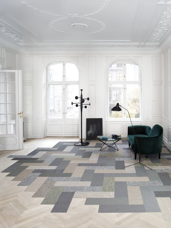 a room with combination of two herringbone tiles, the light brown herringbone, the dark blue, green, brown bigger herringbone