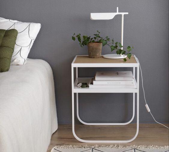 a thin bedside table with wooden top, white thin metal supports