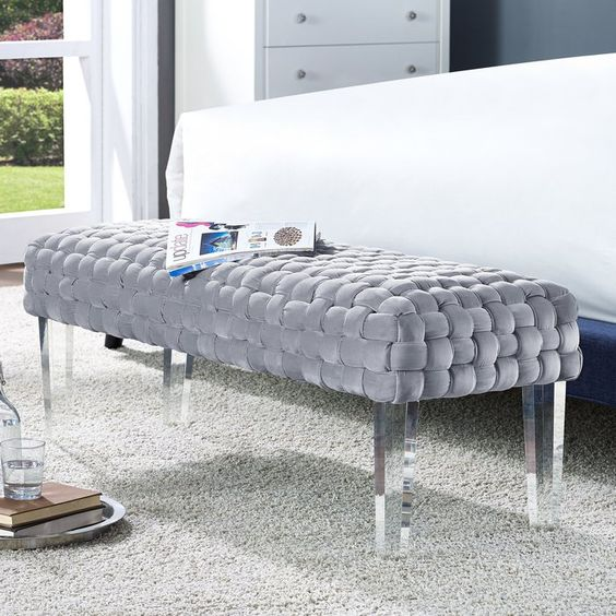 acrylic bench with grey upholster, rug, white cabinet, white bedding