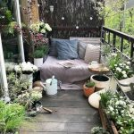 Balcony With Wooden Floor, Wooden Chair With Pillows, Plants On The Floor, Hang On The Wall