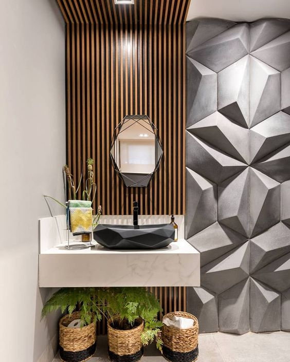 bathroom beige floor, beige wall, wooden accent on wall ceiling, white marble vanity, black geometric sink, grey geometric textured wall, geometric mirror