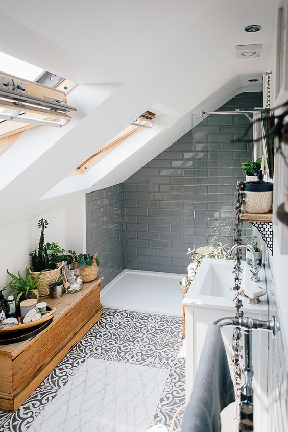 bathroom, patterned floor, white tub, grey subway wall tiles, white wall, glass windows, white sink, wooden cabinet storage