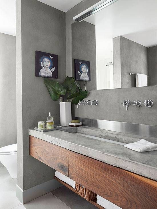 bathroom vanity with concrete sink, concrete wall, frameless mirror, silver faucet, wooden cabinet and shelf under