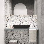 Bathroom Wih Grey Floor, Grey Wall, White Wall, White Terrazzo Accent Wall, Mirror, Grey Floating Vanity With Black Sink