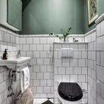 Bathroom With Black And White Floor Tiles, White Square Tiles, Deep Sage Green Wall, White Sink, White Black Toilet