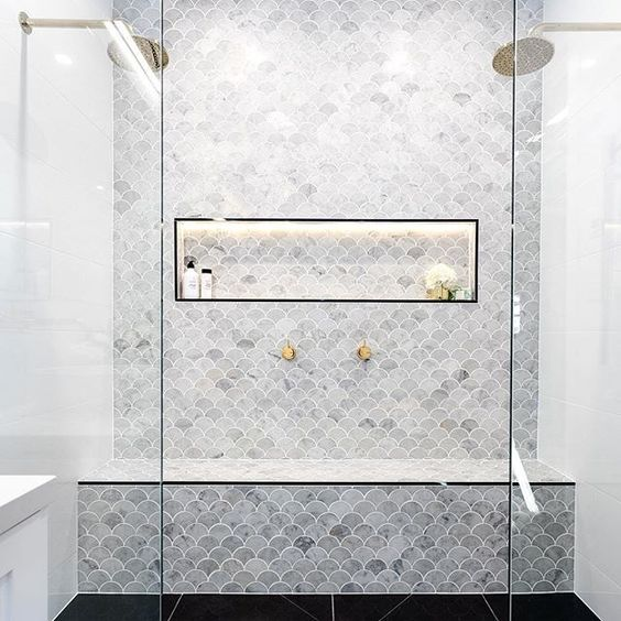 bathroom with black tiles flooring, white tiles wall, white fish scales tiles on accent walls with storage depth