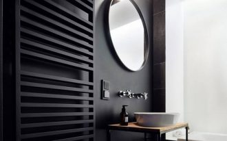 bathroom with black walls, black rails, hexagon tiles cube pattern in black grey, black tiles