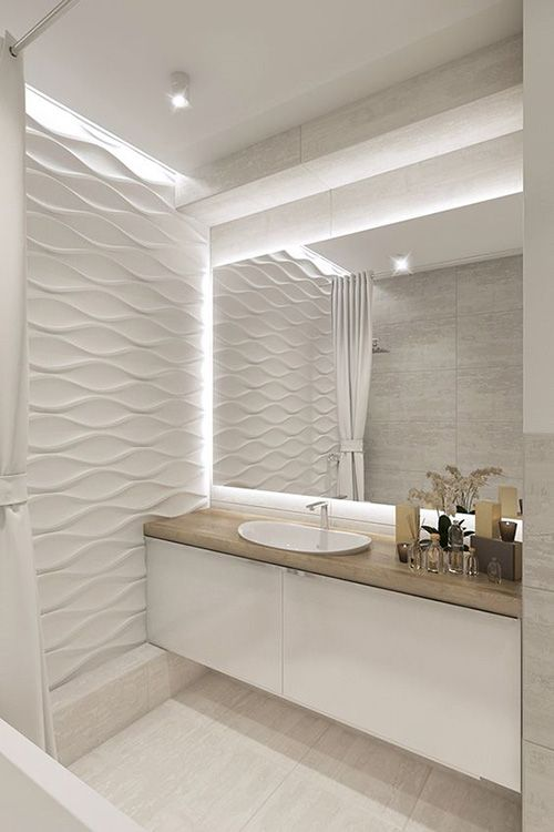 bathroom with white floor, white floating cabinet with wooden top, white sink, white textured wall