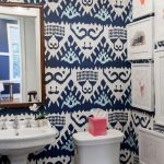 Bathroom With White Floor, White Toilet, White Sink, Mirror, White Framed Pictures, Ikat Wallpaper