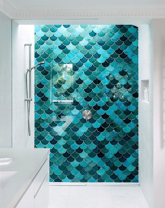 bathroom with white floor, white wall, white cabinet, green blue fish scale tiles on accent wall