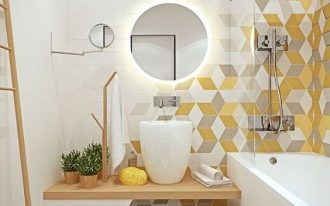 bathroom with white tub, wooden vanity with high sink, hexagon tiles on the shower and tub wall and a little on the grey floor