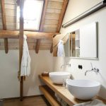 Bathroom, Wooden Floor, Wooden Floating Shelves, White Sink, White Wall, Mirror, Wooden Ceiling, Wooden Beams
