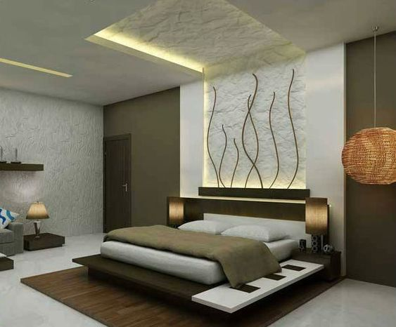 bedroom, bed platform, white bedding, textured wall, white wall, grey wall, white ceiling, textured wall and ceiling, grey flooring, shelf, grey chair with low side table