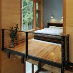 Bedroom On The Upper Loft With Bamboo Floor, Wooden Bed, Plants Indoor, Large Glass Window
