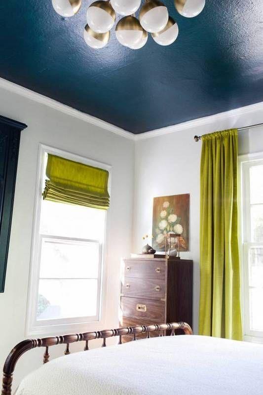 bedroom, white walls, white bedding, metal platform, lime curtain, dark green ceiling, white bulbs chandelier