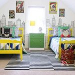 Bedroom With Beige Floor, Striped Rug, Yellow Beds, White Blue Linen, Superhero Pillows, Superhero Posteres, City Wallpaper