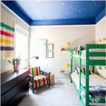 Bedroom With Green Kids Bunk Bed, Grey Rug Flooring, Beige Wall, Black Wooden Chair With Colorful Cushion, Black Wooden Cabinet, Blue Painted Ceiling