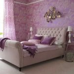 Bedroom With White Rug, Purple Bed, Purple Patterned Wall, Purple Pillows, Wall Decoration. Purple Curtain, Clear Glass Side Table