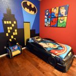 Bedroom With Woode Floor, White Ceiling, Red Wall With 6 Differenct Superheroes Posters, Batmobile Shaped Bed, Wonder Woman Linen, Batman Wallpaper
