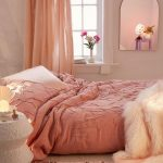 Bedroom With Wooden Floor, Pink Rug, Pink Duvet On Bed, Pink Curtain, White Night Stand, Mirror On The Wall