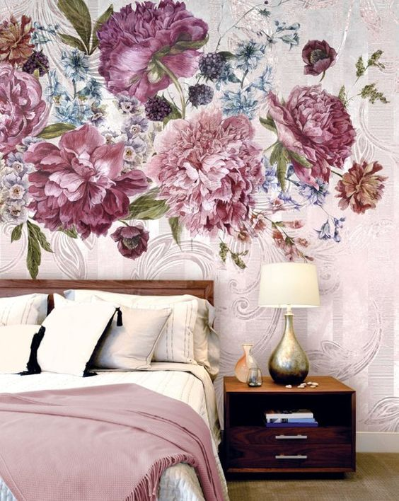 bedroom with wooden floor, wooden platform, white bedding, pink large flowers wallpaper on pink background