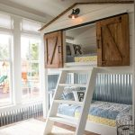 Bedroom With Wooden Floor, Woven Rug, Bunk Bed With The One On Top Has Sliding Doors