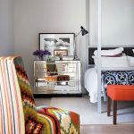 Bedroom, Wooden Floor, White Rug, Colorful Tribal Pattern White Bedding, Mirrored Side Cabinet, Tribal Blanket, Orange Bench